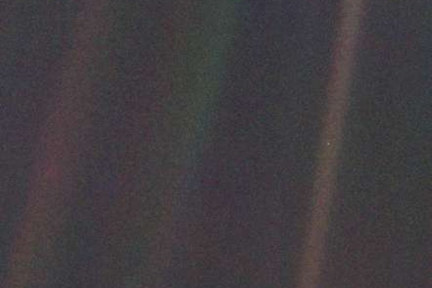 The Pale Blue Dot is a photograph of planet Earth taken in 1990 by the Voyager 1 space probe from a record distance of 4 billion miles from Earth, as part of the solar system Family Portrait series of images. In the photograph, Earth is shown as a fraction of a pixel (0.12 pixel in size) against the vastness of space. The Voyager 1 spacecraft, which had completed its primary mission and was leaving the Solar System, was commanded by NASA to turn its camera around and to take a photograph of Earth across a great expanse of space, at the request of Carl Sagan.